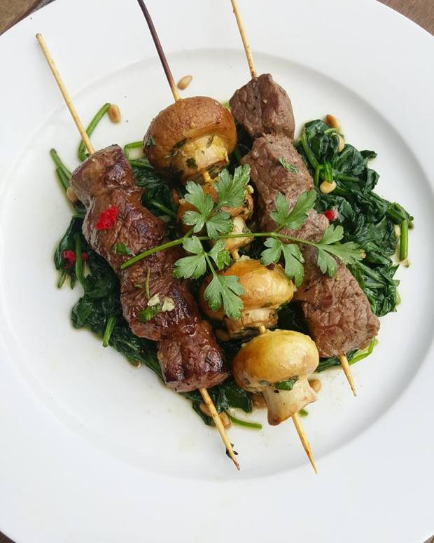 marinated beef and mushrooms skewers with sauteed spinach.jpg